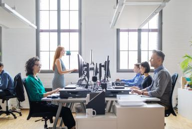 Business people working on computers in open office space