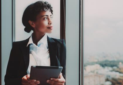 Female business leader looking out window