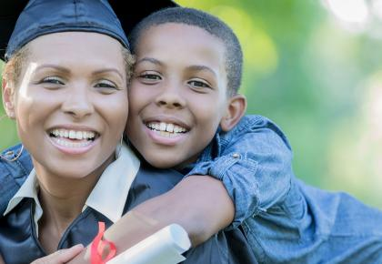 Female Adult Graduate with Son
