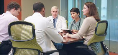 Group of healthcare professionals meeting around a table