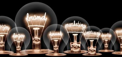 Multiple lightbulbs with various marketing related words inside