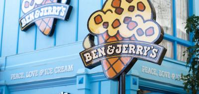 Front of Ben & Jerry's scoop shop with large ice cream cone sign