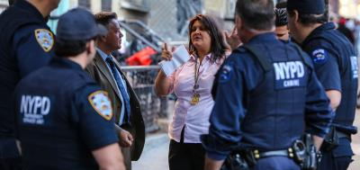 Woman speaking with NYPD officers