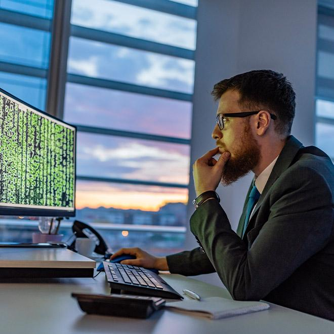 Cybersecurity professional on a computer in an office